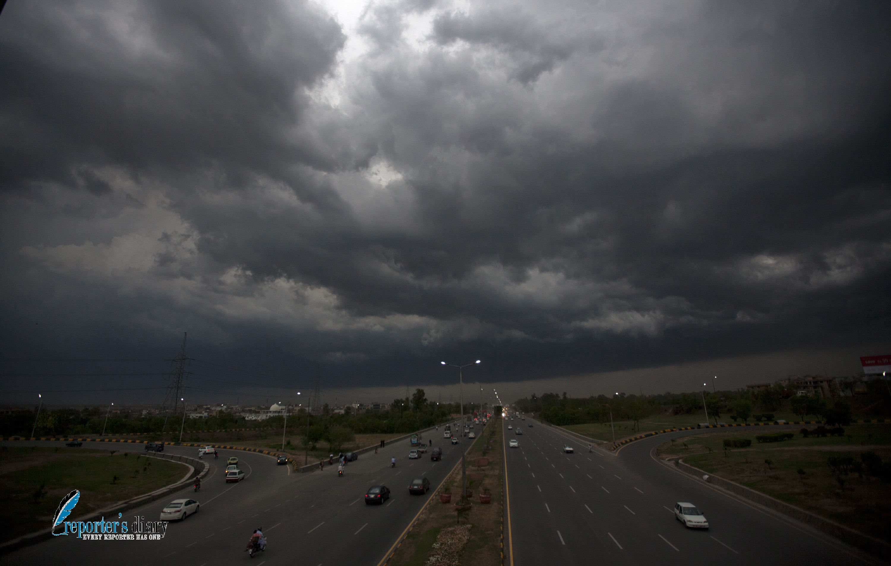Dark clouds over the capital photo by Mian Khursheed