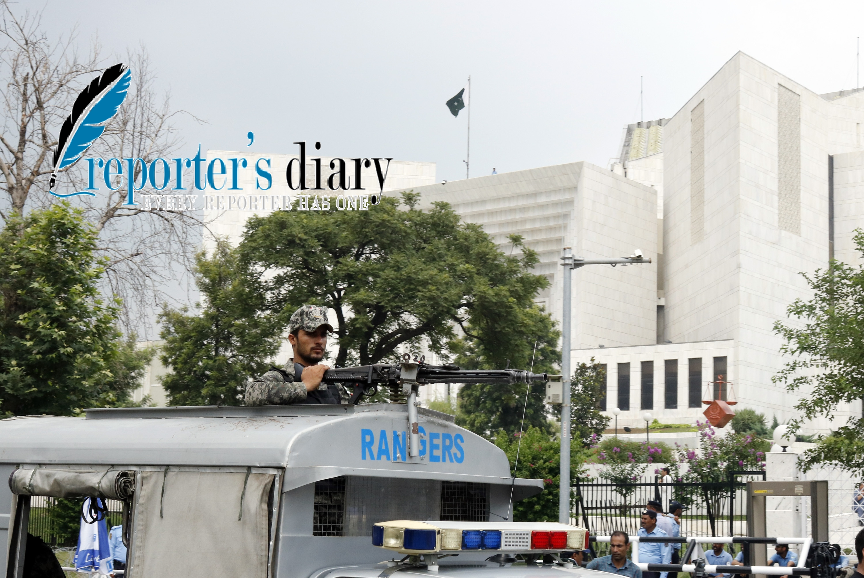 Police and security officers stand guard outside the Supreme Court of Pakistan building in Islamabad