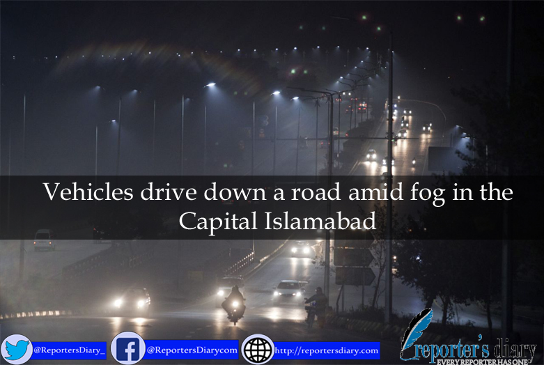 Vehicles drive down a road amid fog in the Capital Islamabad
