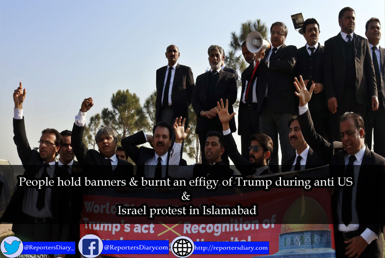 People hold banners & burnt an effigy of Trump during anti US & Israel protest in Islamabad